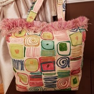 Multicolored tote with fringe trim